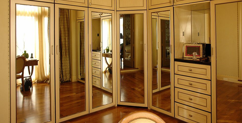 Custon built-in Wardrobe system with mirror doors
