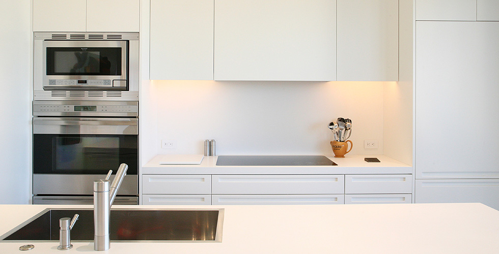 Contemporary cabinetry in the kitchen, bathroom, bedroom and office.