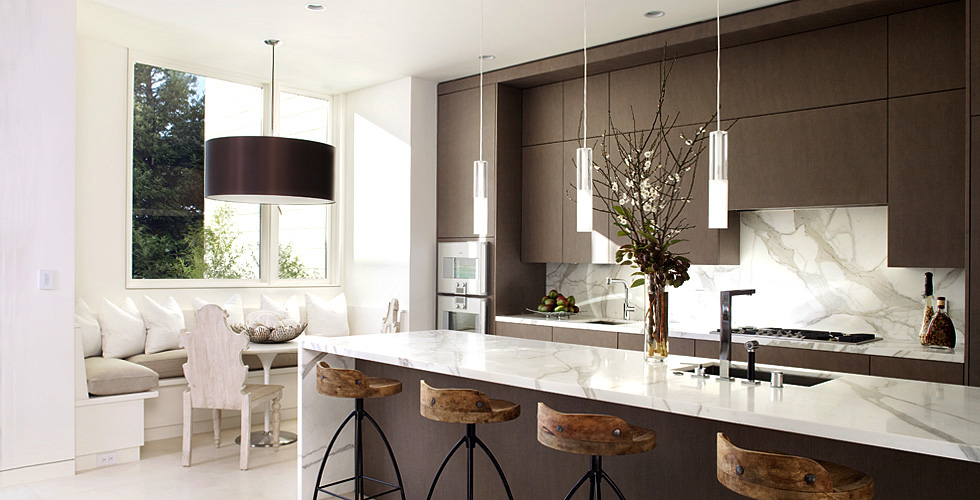 Contemporary kitchen features dark stained cabinets