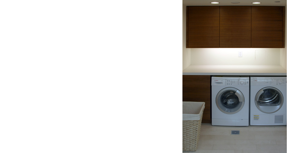 Contemporary laundryroom dark stained cabinets.