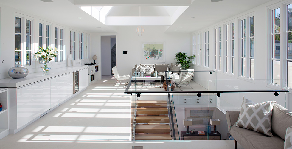 Contemporary living room with white high gloss cabinetry