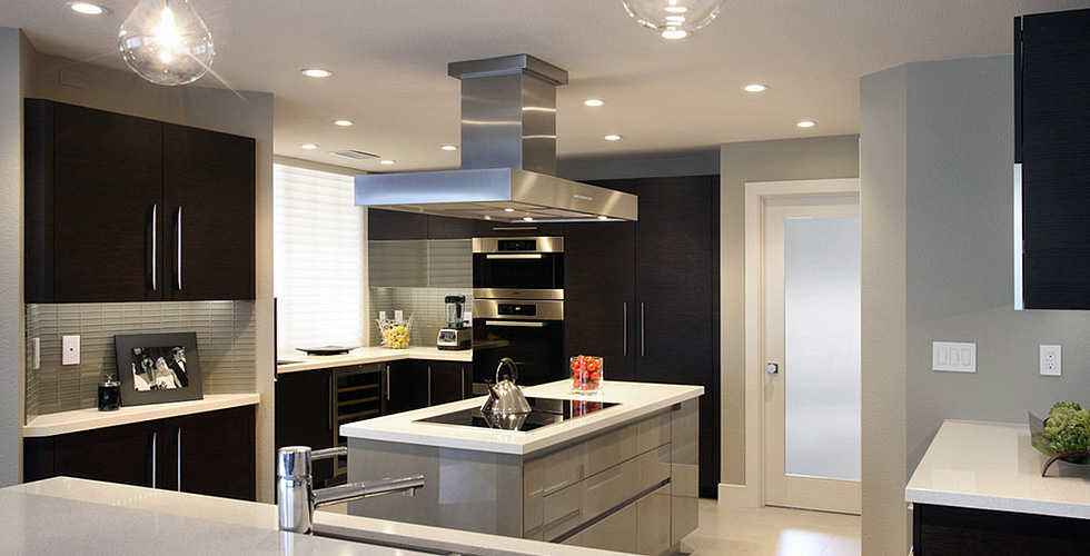 Kitchen island with a seamless channel for opening the doors and drawers